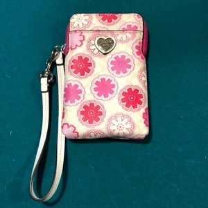 Woman's  pink flower coach wristlet